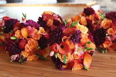 Beautiful fall bouquets using Dahlia's, calla lilies, freesia, ranunculus and roses.  Designed by Eastern Floral.