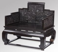 """Late 19th century Chinese carved zitan throne armchair, the stepped back and arms ornately embellished with dragons amidst waves and rockwork, the back with a central facing dragon surrounding a flaming pearl, over a wide rectangular seat raised on elephant legs set into the base stretcher, 44""""h x 46.5""""w x 33.5""""d."""