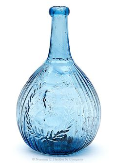 """""""Jeny Lind"""" And Bust - Factory Portrait Calabash Flask, probably Ravenna Glass Works, Ravenna, Ohio, 1845-1860. Brilliant light to medium sapphire blue with deeper blue striations above and to the right of the bust, applied round collared mouth - huge red iron pontil mark, quart; (some minor interior stain, 1/8 inch interior horizontal manufacturer's fissure in one of the side ribs). GI-104 Great color, strong embossing, beautiful bottle. #Bottles #Flasks #MADonC"""