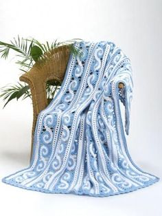 Victorian Spirals Crochet Throw | This unique Victorian Spirals Crochet Throw is made by crocheting strips of joined spiral motifs - try it today!