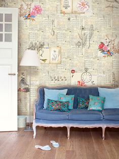 wall with book pages How to Decorate Your Home Using Books