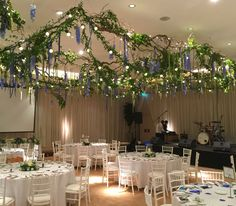 Ivory trevira drapes by www.stressfreehire.com, plus a willow, foliage and festoon floral chandelier by the Hybrid Flower Company