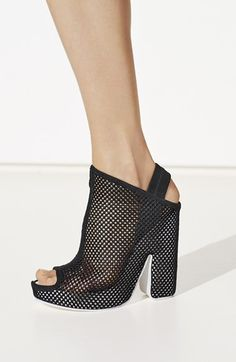 """Free shipping and returns on Balenciaga Open Toe Mesh Platform Mule (Women) at Nordstrom.com. <p><B STYLE=""""COLOR:#990000"""">Pre-order this style from the Spring 2015 collection! Limited quantities. Ships as soon as available. You'll be charged only when your item ships.</b></P><br>The striking sculptural aesthetic of Cristóbal Balenciaga is married with current creative director Alexander Wang's sporty leanings in this breathtaking open-toe mesh mule grounded by a wrapped white-lacquered…"""