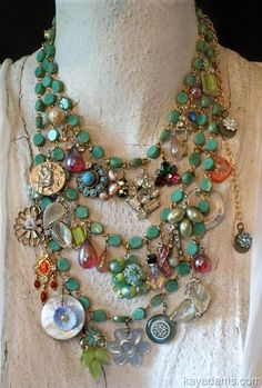 Bits of broken jewelry and buttons and beads, suspended from a 3 tiered bead necklace....
