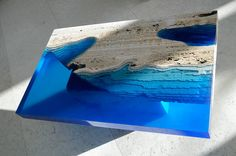 Designer Alexandre Chapelin of LA Table designed this intriguing series of three tables he refers to as Lagoon Tables. Each table is formed from a carved travertine base to which he adheres a special resin that forms volumes of water that appear to slice through each piece. The tables are undoubtedl