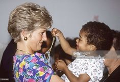 (FILE PHOTO) Princess Diana, Princess of Wales is seen cuddling a child during a visit to a hostel for abandoned children many of whom are HIV positive or suffer from AIDS on April 24, 1991 in Sao Paolo, Brazil. (Photo by Tim Graham/Getty Images)