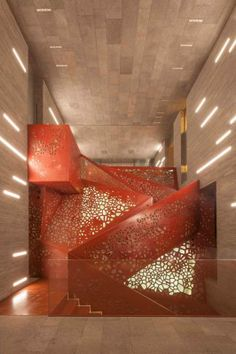 Illuminated feature staircase made out of perforated continuous folded copper with no visible fixings. Via urdesign by ARUP photos QUINTIN LAKE