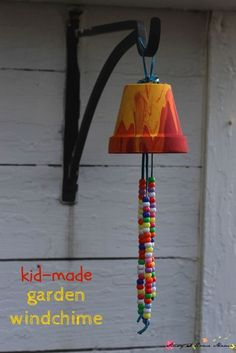 Kids Craft Idea: Homemade Garden Wind Chime, a sweet gift and a great way to decorate your garden using pour painting process art and hand-strung beads #kidscrafts