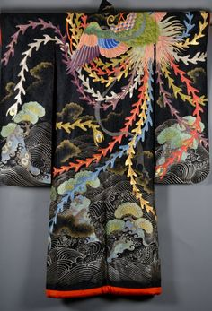 Japan, black ground uchikake, depicting a pheonix, the sea and clouds, all parts finely embroidered