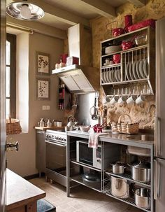 Love the functionality of this kitchen. I've always liked the idea of a kitchen closed off from the rest of the house