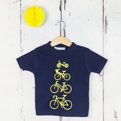 Personalised Bikes T shirt Love your bike? Personalise your t shirt with your familys bikes in a range of bright, cheerful colours. The bikes will be printed vertically down the t shirt starting with the smallest.  Choose your bikes from: racing bike, ladies bike, bike with basket, girls bike, girls bike with basket, boys bike and balance bike.  Sizes available are: 1 - 2 yrs, 2 -3 years, 3 - 4 yrs , 4 -5 years and 5 - 6 years plus 7- 8 years and 9-10 years in navy. For the bikes choose from…