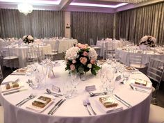 White and blush pink wedding centrepiece - roses and hydrangea - wedding reception flowers - merrydale manor - Laurel Weddings