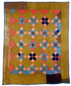 Nine Patch on Point Quilt, ca. 1850 - 1870 Possibly made by Catherine Beachy Kauffman (1818 - 1896) This wool quilt is hand pieced and hand quilted with double parallel lines in the pieced blocks, three concentric circles in the plain blocks, and chevrons in the borders. The batting is cotton, and the backing is blue cotton that folds to the front as binding. Size: 66 by 79 inches