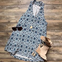 The keyhole neck trend gets a feminine touch in this pretty tunic dress from Karlie! Shop in store or call to order 678-309-9550! #shopatl #atlantaboutique #shopsmall #shoplocal #stayHIP #handinpocket #springtrends #ootd #outfitinspiration #keyhole #mockneckdress #trendy #floraldress #karlieclothes #summeroutfit #pretty