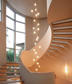 Use large globe light bulbs to make a statement in stairway ceiling fixtures. #stairlighting
