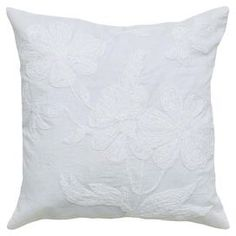 "Cotton pillow with floral embroidery.   Product: PillowConstruction Material: Cotton voille cover and polyester fillColor: WhiteFeatures:  Insert includedHidden zipper closureEmbroidery and applique details Dimensions: 18"" x 18""Cleaning and Care: Spot clean only"