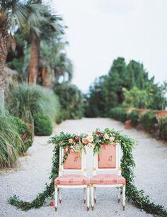 Garland covered wedding chairs: http://www.stylemepretty.com/little-black-book-blog/2014/12/23/elegantly-festive-tuscan-wedding-inspiration/   Photography: Anthem - http://anthemphotography.com/
