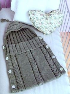 Knitting Pattern for Cabled Baby Sleeping Bag - Great simple sleep sack with hood, cable details, and buttons down the sides. One size – newborn to 3 months
