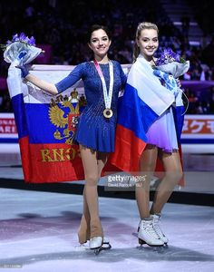 Gold medalist Evgenia Medvedeva of Russia and Bronze medalist Elena Radionova of Russia pose during the Ladies final medal ceremony during day three of the ISU Grand Prix of Figure Skating Final 2015/2016 at the Barcelona International Convention Centre on December 12, 2015 in Barcelona, Spain.