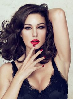Monica Belluci for Dolce & Gabbana. Lipstick is DOLCE & GABBANA Monica Voluptuous Lipstick Try MAC chili for a similar color.