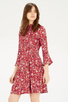 This floral dress is constructed from a casual woven fabric and features a high neck, puff shoulder detailing, a nipped in waist and 3/4 length fluted sleeves. Height of model shown: 5ft 10 inches/178cm. Model wears: UK size 10.