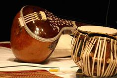 The tanpura ; or tambura, tanpuri may be a long-necked plucked string instrument, originating from Asian nation, found in varied forms in Indian music. It doesn't play melody and it's not a supporting acoustic providing an eternalharmonic drone or drone.