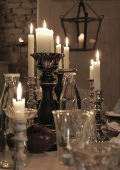 Candles. Various holder styles with half burnt candles covering a whole end table would look great