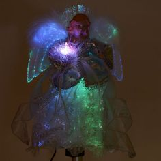 I like this photo of this Angel Tree Topper in the dark, so you can really see how she lights up from head to toe!