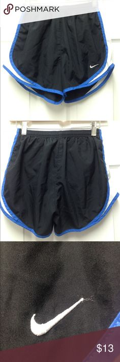 Nike running shorts Black Nike running short with white and Royal blue trim. They have to undergarment inside and a drawstring waist. The swoosh is sewn on and I'm prefect condition. Nike Shorts