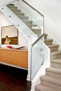Glass panel attached to side of stair with stand off posts. (Jodie Rosen Design) http://www.houzz.com/photos/931981/Stair-Detail-modern-staircase-toronto