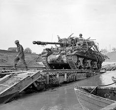 An Achilles 17pdr tank destroyer crossing the River Savio on a Churchill ARK which was driven into the river, Italy, 24 Oct 1944