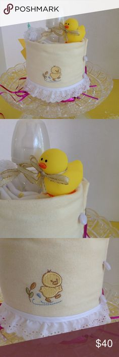 "RUBBER DUCKY Baby Shower Diaper Cake NEW Our rubber ducky diaper cake is the ideal centerpiece for any baby shower. It will delight the expectant mother and be the highlight of the party. 8"" x 8"" x 10"" H, Contains: 2 receiving blankets 4 newborn diapers 1 bottle 1 rubber ducky 1 pair of frilly white socks 2 candles 2 diaper pins 1 gift card  {Everything needed for the new mother} All of our products are safe and nontoxic from premium brands only. Shipping: Each cake is baked by hand and will…"