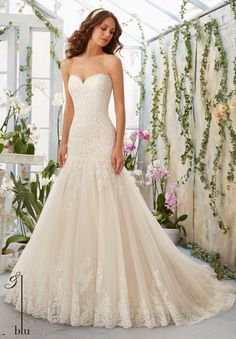 """Wedding Gowns By Blu featuring Alencon Lace Appliques on Tulle Gown with Scalloped Hemline Available in Three Lengths: 55"""", 58"""", 61"""". Colors available: White, Ivory, Ivory/Cameo."""