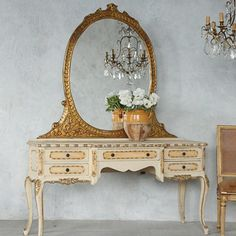 Vintage Vanity Table and Mirror adds glamour and history to your powder room.