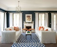 Great blue and white rug. Cool fireplace surround