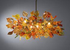 Orange flowers. Hanging chandeliers.. $1,070.00, via Etsy.