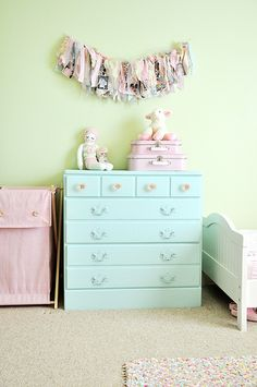 Super cute dresser before and after.  A new coat of paint and some glass drawer pulls, and you're in business.