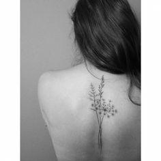 Hand poked tattoo on the upper back. Tattoo artist: Lara M. J.