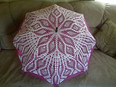 Crochet doily umbrella The ravelry link is hosed. There is an archive link that goes back to a vintage doily that was used for the umbrella.