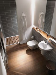 This modern small bathroom design uses wall hung units to open up the floor space.