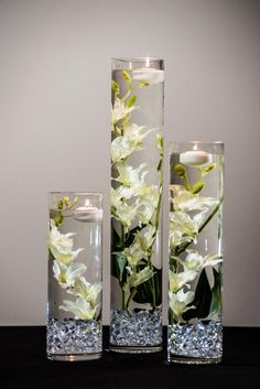 This Submersible White Star Flower Floral Wedding Centerpiece with Floating Candles and Acrylic Crystals Kit is just one of the custom, handmade pieces you'll find in our centerpieces shops. Cylinder Vase Centerpieces, Floating Candle Centerpieces, Simple Wedding Centerpieces, Wedding Decorations, Centerpiece Flowers, Quinceanera Centerpieces, Graduation Centerpiece, White Floral Centerpieces, Floating Candles Wedding