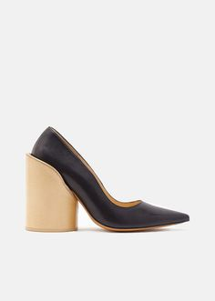 7dcff334b781 Black leather pointed-toe pumps with mismatched rectangular and cylindrical  oversized heels wrapped in a