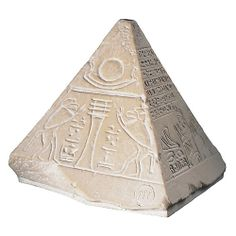 Pyramids of ancient Egypt were topped with a special stone called a pyramidion. This one is from a High Priest's tomb.