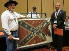 Battle Flag of the Third Tennessee Infantry. At the recent Sons of Confederate Veterans National Reunion, the Tennessee State Museum folks were kind enough to bring down one of the flags we helped save. This picture includes Ronny Mangrum (who continues to lead from the front), Sam Goodman, and James Turner. This is a Battle Flag of the Third Tennessee Infantry.