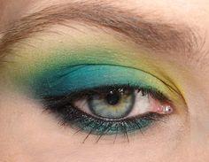 "MAC ""Sunny Spot"" eyeshadow (sheer matte lime yellow), MAC ""Cool Heat"" eyeshadow (teal blue with green/gold shimmer), MAC ""Plumage"" eyeshadow (matte blackened teal)"