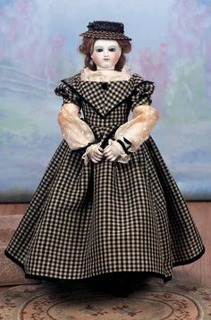 French Bisque Poupee with wood body.  ca. 1863   Theriault's Antique Doll Auctions