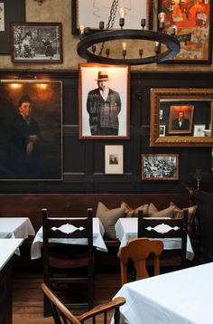 A gallery wall at The Lion restaurant in Manhattan, designed by BHDM Design