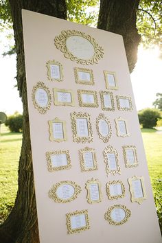 beautiful seating chart with gold frames