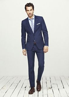 The navy suit is always a good choice for an interview, guys!  Check out some of our interview and job search advice on www.livecareer.com