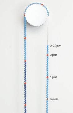 SASA CLOCK 24 Hour Version - by Thorunn Arnadottir - order via sasaclock.com Minutes — Light blue beads for the 6 am to 6 pm, dark blue beads for the 6pm to 6am hours. Hours: Orange beads, Noon: Gold bead, Midnight: Silver bead